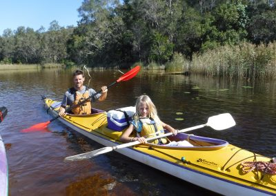 Family kayaking in the Noosa Everglades